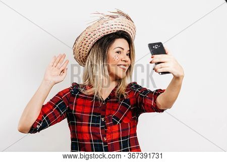Woman Wearing Typical Clothes For Festa Junina Making Video Call On Cell Phone