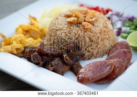 Thai Food - Kao Cluk Ka Pi (mixed Cooked Rice With Shrimp Paste Sauce) On White Round Dish. Fried Ri