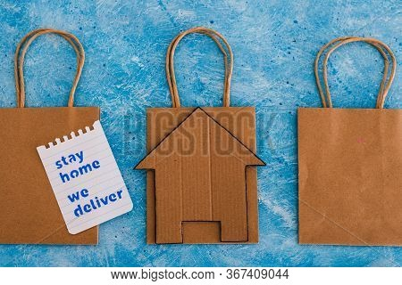 Restaurant Takeaway Shopping Bags With House Icon And Stay Home We Deliver Message.