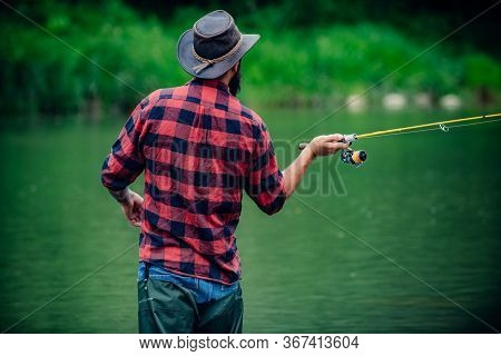 Gone Fishing. Fishing Freshwater Lake Pond River. Hobby And Sport Activity. Successful Fly Fishing.