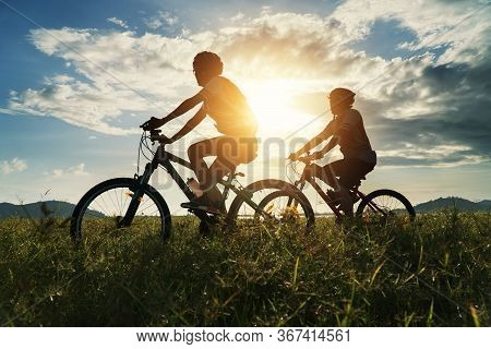 Young Couple In Love Fun And Happy Riding Mountain Bike After Covid-19 Coronavirus Outbreak. End Of
