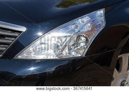 Novosibirsk/ Russia - May 03 2020: Nissan Teana, Macro View Of Modern Black Car Xenon Lamp Headlight