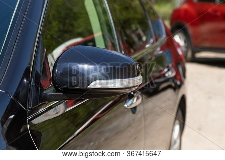 Novosibirsk/ Russia - May 03 2020: Nissan Teana,side Mirror Of A Black Car Close-up. Exterior Detail
