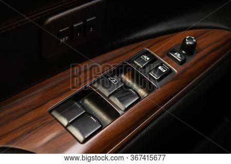 Novosibirsk/ Russia - May 03 2020: Nissan Teana,interior Of Modern Car. Side Door Buttons: Window, M