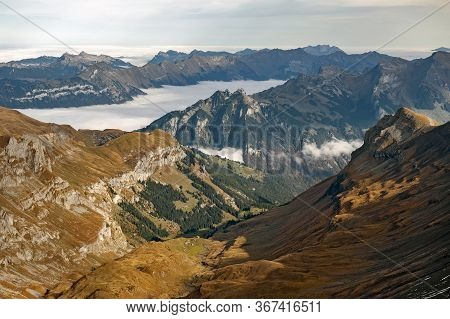 Scenic View Of Snow-capped Mountains Of The Swiss Alps Skyline Seen From The Schilthorn, A Summit In