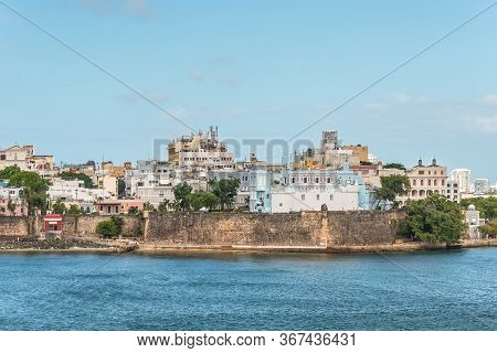 San Juan, Puerto Rico - April 29, 2019: Buildings On The Coast Of San Juan, Puerto Rico.