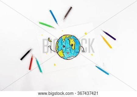 Childrens Drawing Of Our Planet On A White Sheet Of Paper.