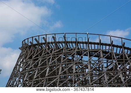 Roller Coaster In An Amusement Park Without A Car In Front Of Blue Sky