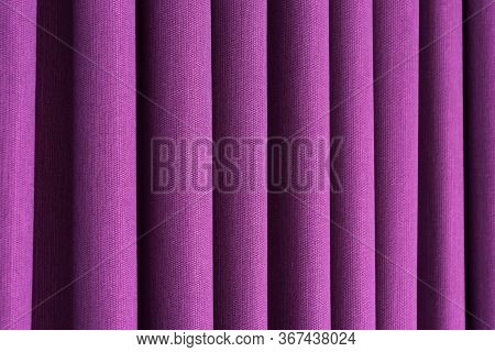 Closeup View Of Lilac Curtain In Thin And Thick Vertical Folds Made Of Dense Fabric.textured Materia