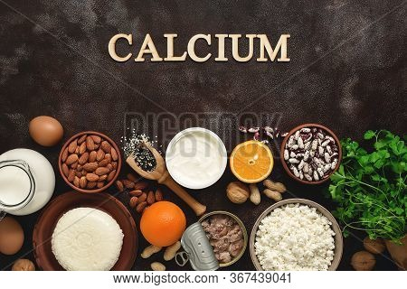High Calcium Foods On A Dark Rustic Background. A Variety Of Products Rich In Calcium. Top View, Fla