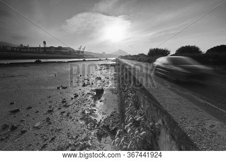Erandio, Bizkaia/basque Country; Jul. 19, 2013. A Vehicle Circulates On The Road That Goes Along The
