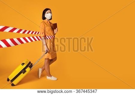 Pretty Woman In Protective Mask Tearing Red Warning Tape On Tvivid Yellow Background