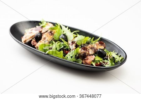 A Chicken Salad With Rucola Bacon And Tomato
