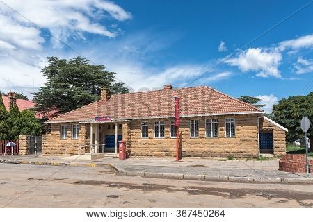 Clocolan, South Africa - March 20, 2020: A Street Scene, With The Post Office, In Clocolan In The Fr