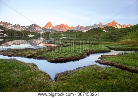 Wetland With Winding Brooks At Lacs De Fenetre With Reflection At Sunrise And Grand Jorasses; Val Fe