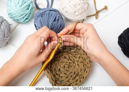 Different Colored Balls Of Yarn. Children's Hands Are Crocheted And Thread View Frome Above