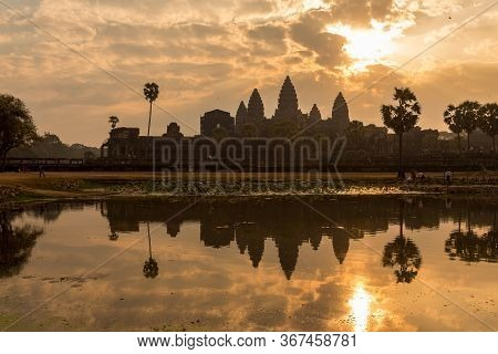 Sunrise At Angkor Wat Temple, Cambodia. It Is One Of The Mysterious Ruin Complex In South Asia And A