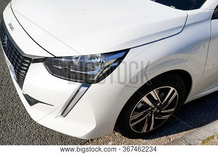 Bordeaux , Aquitaine / France - 02 11 2020 : Headlight New Peugeot 208 Front Car White Produced By T