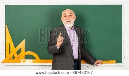 Information Is Everywhere But Wisdom Is Scarce. Man Bearded Tutor In Classroom. Formal Education. Ma