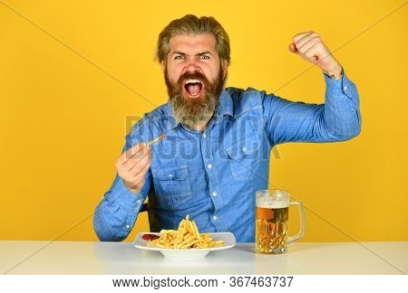 Friday Party Concept. Good Appetite. Consume Alcohol. Enjoy Your Meal. Beer And Food. Dinner At Pub.