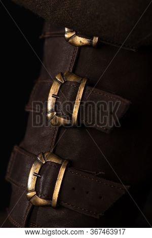 Close Up View Of Medieval Scottish Brown Leather Shoes With Buckles