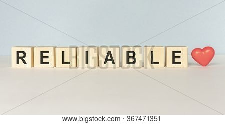 Reliable Word Written On Wood Block On A Light Background
