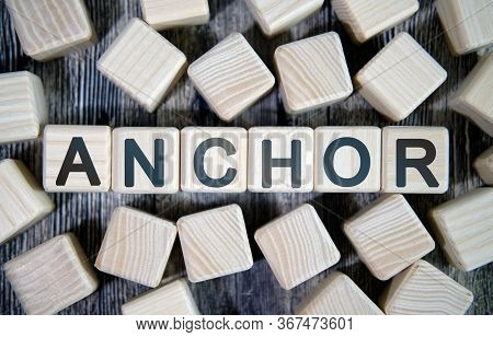 Anchor Links - Text Concept Website On A Wooden Background Surrounded By Cubes