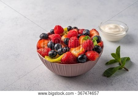 Fresh Fruit Salad With Different Ingredients With Mint And Sour Cream. Healthy Diet. Copy Space For