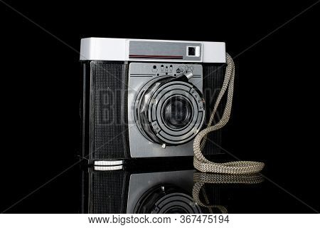 One Whole Vintage Camera One Lens Isolated On Black Glass