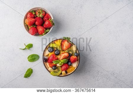 Fresh Fruit Salad With Different Ingredients And Mint. Healthy Diet. Copy Space For Text. Top View