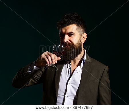 Man Holding Glass Of Cabernet Or Red Wine And Bottle