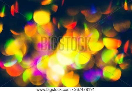 Abstract Blurred Background Of Glitter Lights Of Different Colors. Out Of Focus.