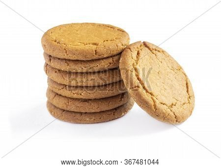 Close Up Plie Of Ginger Biscuits With One Stood    Isolated On A White Background