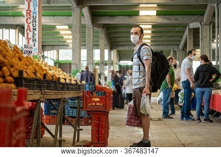 Eskisehir, Turkey - May 21, 2020: Man With Medical Mask At Traditional Turkish Grocery Bazaar During