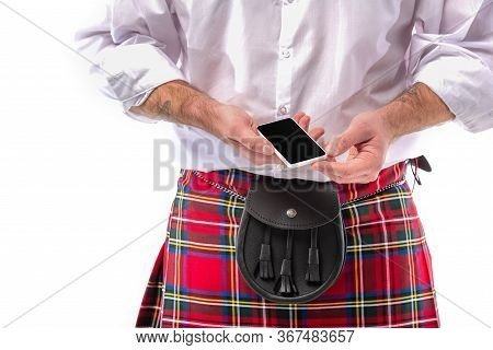 Cropped View Of Scottish Man In Red Kilt With Leather Belt Bag And Smartphone Isolated On White