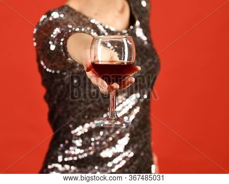 Lady Holding Cabernet Or Merlot. Girl In Shining Dress