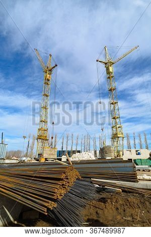 Iron Fittings For The Construction Of A New Building Is On A Construction Site On The Background Of