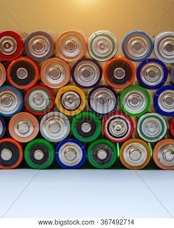 Closeup Of Saws Of Used Alkaline Batteries. Several In Rows. Ecological Pollution.
