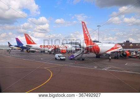 Luton, Uk - July 12, 2019: Easyjet Airbus A319 Fleet With Wizzair And Ryanair In Background At Londo