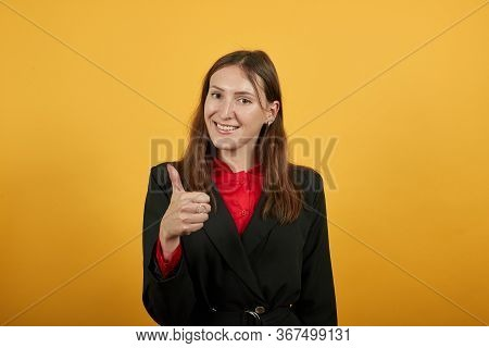 Young Attractive Brunette Woman In Black Stylish Suit, Red Shirt On Yellow Background, Happy Female
