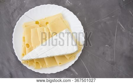Slices Of Cheese, Medium Hard Cheese, Homemade Or Swiss Cheese And Hard Cheese On A White Plate. Fre