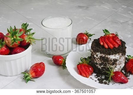 Tasty Fresh Milk On A White Wooden Background. Homemade Cookies And A Glass Of Milk. Strawberry.