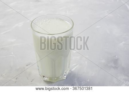 Tasty Fresh Milk On A White Wooden Background. A Glass Of Milk. Copy Space