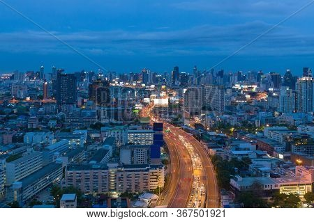 Aerial View Of Bangkok Downtown Skyline, Highway Roads Or Street In Thailand. Financial District And
