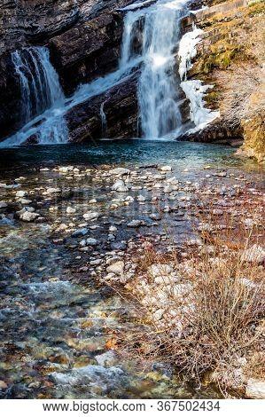 Cameron Falls In Late Fall. Waterton Lakes National Park, Alberta, Canada