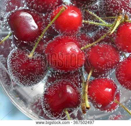 Sweet Cherries And Bubbles In Water, Close Up