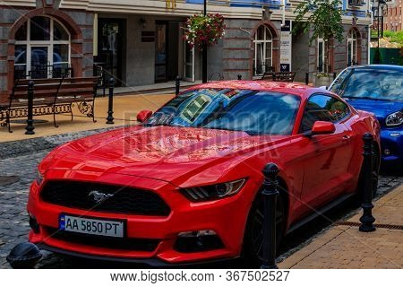 Kiev, Ukraine - July 28, 2018: Modern Red Ford Mustang Parked On The City Street