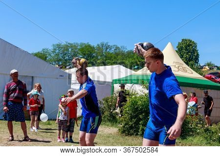 Dnepropetrovsk Region, Ukraine - June 2, 2018: Young Athletes Performs Exercises With Dumbbells Duri
