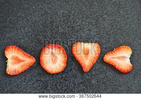 Love Letters Strawberry Slices Isolated On Black Background
