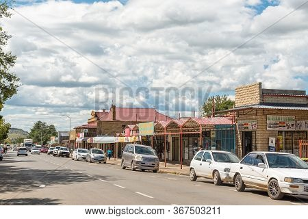 Ladybrand, South Africa - March 20, 2020: A Street Scene, With Businesses People And Vehicles, In La